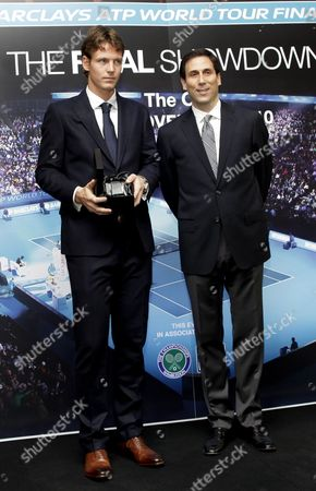 Stock Picture of Tomas Berdych with ATP World Tour CEO Adam Helfant
