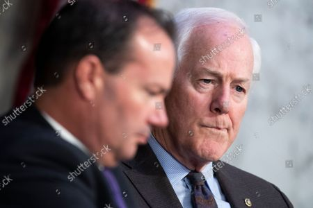 """UNITED STATES - SEPTEMBER 29: United States Senator John Cornyn (Republican of Texas), right, and US Senator Mike Lee (Republican of Utah), attend the Senate Judiciary Committee hearing titled """"Texas's Unconstitutional Abortion Ban and the Role of the Shadow Docket,"""" in Hart Senate Office Building in Washington, D.C., on Wednesday, September 29, 2021."""