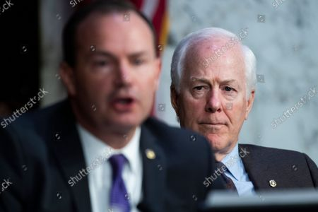 """UNITED STATES - SEPTEMBER 29: United States Senator John Cornyn (Republican of Texas), right, and United States Senator Mike Lee (Republican of Utah), attend the Senate Judiciary Committee hearing titled """"Texas's Unconstitutional Abortion Ban and the Role of the Shadow Docket,"""" in Hart Senate Office Building in Washington, D.C., on Wednesday, September 29, 2021."""