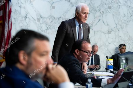 """Stock Photo of UNITED STATES - SEPTEMBER 29: From left, United States Senator Ted Cruz (Republican of Texas), US Senator John Cornyn (Republican of Texas), and US Senator Mike Lee (Republican of Utah), attend the Senate Judiciary Committee hearing titled """"Texas's Unconstitutional Abortion Ban and the Role of the Shadow Docket,"""" in Hart Senate Office Building in Washington, D.C., on Wednesday, September 29, 2021."""