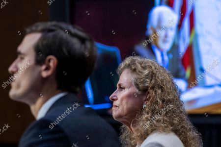 """UNITED STATES - SEPTEMBER 29: Texas State Rep. Donna Howard, District 48, and Edmund Gerard LaCour Jr., Alabama solicitor general, listen to United States Senator John Cornyn (Republican of Texas), on monitor at right, during the Senate Judiciary Committee hearing titled """"Texas's Unconstitutional Abortion Ban and the Role of the Shadow Docket,"""" in Hart Senate Office Building in Washington, D.C., on Wednesday, September 29, 2021."""