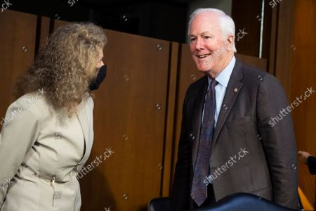 """UNITED STATES - SEPTEMBER 29: United States Senator John Cornyn (Republican of Texas), and Texas State Rep. Donna Howard, District 48, talk before the Senate Judiciary Committee hearing titled """"Texas's Unconstitutional Abortion Ban and the Role of the Shadow Docket,"""" in Hart Senate Office Building in Washington, D.C., on Wednesday, September 29, 2021."""