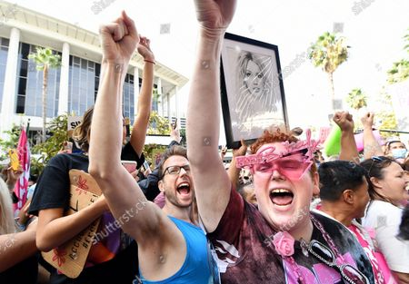 Britney Spears fan that goes by the name Jakeyonce, right, celebrates outside the courtroom after the announcement that Britney Spears' father, Jamie spears, is suspended from her conservatorship in Los Angeles Wednesday. (Wally Skalij/Los Angeles Times)