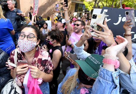 Stock Picture of Britney Spears fans cheer outside the courthouse after the announcement that Britney Spears' father, Jamie spears, is suspended from her conservatorship in Los Angeles Wednesday. (Wally Skalij/Los Angeles Times)