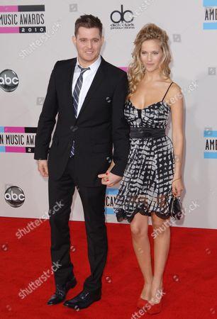 Stock Image of Michael Buble with fiancee Luisana Loreley Lopilato