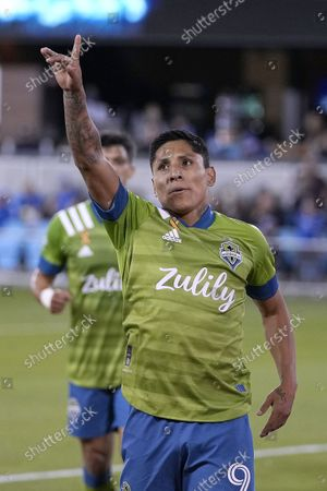 Seattle Sounders forward Raul Ruidiaz points to the crowd after scoring a goal on a penalty kick against the San Jose Earthquakes during the first half of an MLS soccer match, in San Jose, Calif