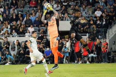Stock Photo of Portland Timbers goalkeeper Steve Clark, center, stops a shot next to Los Angeles FC forward Raheem Edwards, right, during the second half of an MLS soccer match, in Los Angeles