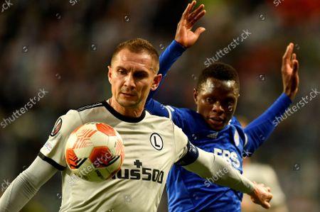 Artur Jedrzejczyk of Legia Warsaw  and Patson Daka of Leicester City