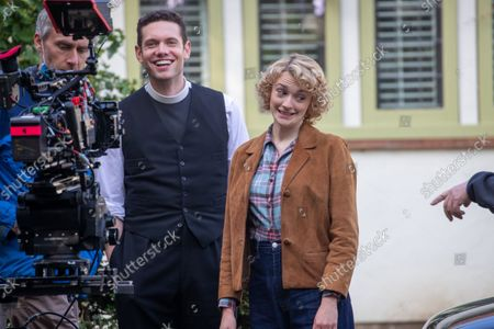 Stock Photo of actress Charlotte Ritchie filming the ITV drama Grantchester looking unrecognisable to her normal roles. She is pictured with actor Tom Brittney. Ghosts actress Charlotte Ritchie looked unrecognisable as she sported blonde curly hair for her role in ITV's crime drama Grantchester.The 31-year-old brunette looked a world apart from her character Alison in the popular BBC One sitcom.In fact, Charlotte looked more like her character, Barbara Gilbert in BBC's period drama Call the Midwife, as she cycled around the streets of Grantchester in Cambridgeshire in 1950s attire.She was seen wearing a red and white checked shirt, stylish blue jeans and red shoes