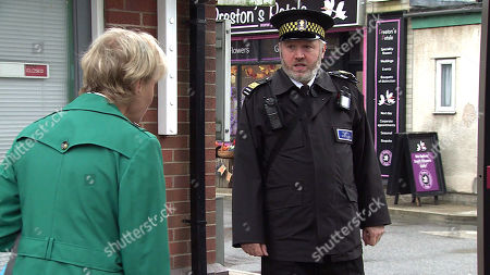 Coronation Street - Ep 10446 Monday 4th October 2021 - 1st Ep Sally Metcalfe's, as played by Sally Dynevor, outraged to spot Councillor Cameron's car parked on the street again and persuades Fergus, as played by Toby Hadoke, to issue him with a ticket for obstructing a dropped kerb.