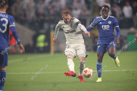 Artur Jedrzejczyk (L) of Legia and Patson Daka (R) of Leicester City in action during the UEFA Europa League group C soccer match between Legia Warsaw and Leicester City in Warsaw, Poland, 30 September 2021.