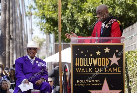 Marshall Thompson, left, a founding member of the R&B group The Chi-Lites, listens as actor Jimmie Walker speaks during a ceremony to award The Chi-Lites a star on the Hollywood Walk of Fame, in Los Angeles