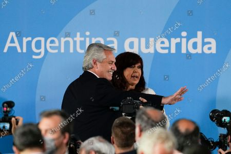 Argentina's President Alberto Fernandez, left, and Vice President Cristina Fernandez leave after attending a ceremony to announce agro-economic measures, at the government house in Buenos Aires, Argentina