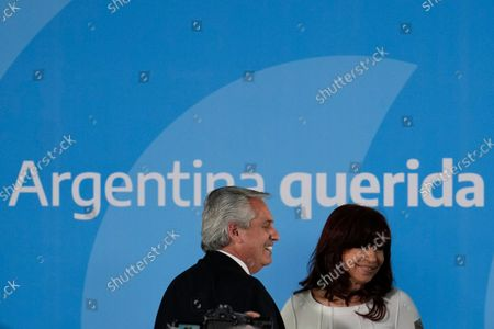 Argentina's President Alberto Fernandez, left, and Vice President Cristina Fernandez leave after attending a ceremony to announce agro-economic measures at the government house in Buenos Aires, Argentina