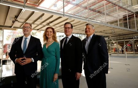 Bill Kramer, Director and President, Academy Museum, Dawn Hudson, CEO, Academy of Motion Picture Arts and Sciences, David Rubin, President, Academy of Motion Picture Arts and Sciences, and Ted Sarandos, Co-CEO and Chief Content Officer, Netflix, left to right, pose for photos as they gather in the Academy Museum's Walt Disney Company Piazza for the ceremony marking opening day for the Academy Museum of Motion Pictures. The ceremony included a ribbon cutting and civic dedication before opening its doors to first time visitors to the museum - the largest in the nation dedicated to movies and moviemaking. Academy Museum on Thursday, Sept. 30, 2021 in Los Angeles, CA. (Al Seib / Los Angeles Times).