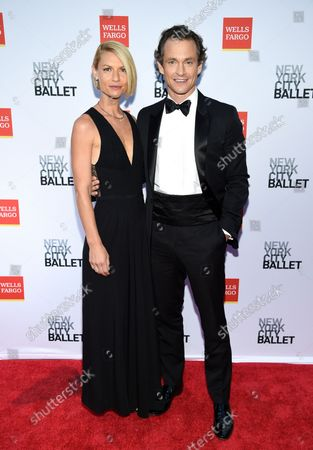 Stock Photo of Actors Claire Danes, left, and Hugh Dancy attend the New York City Ballet Fall Fashion Gala at the David H. Koch Theater at Lincoln Center, in New York