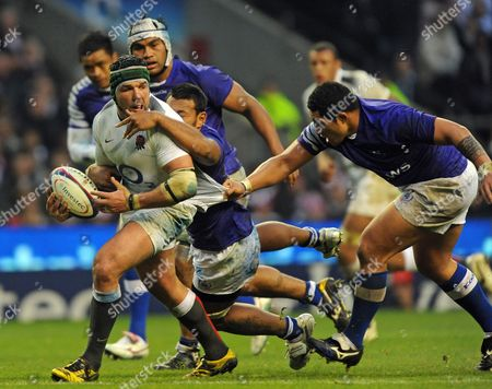Hendre Fourie of England is tackled Anthony Perenise of Samoa