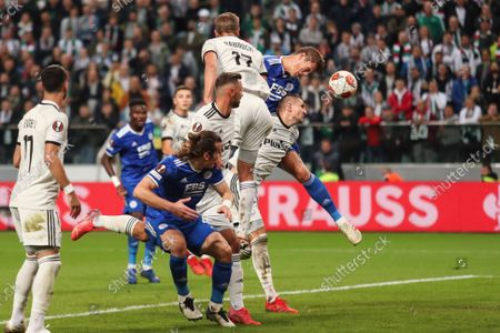 Stock Photo of (211001) - WARSAW, Oct. 1, 2021 (Xinhua) - Jannik Vastergaard (R, top) of Leicester wins a header with Artur Jedrzejczyk of Legia during the Europa League Group C football match between Legia Warsaw and Leicester City in Warsaw, Poland, Sep 30, 2021.