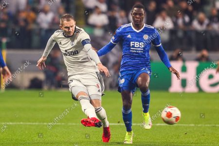 (211001) - WARSAW, Oct. 1, 2021 (Xinhua) - Artur Jedrzejczyk (L) of Legia lives with Patson Daka of Leicester during the Europa League Group C football match between Legia Warsaw and Leicester City in Warsaw, Poland, Sep 30, 2021.