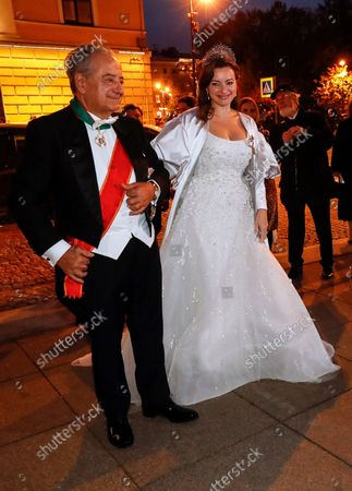Stock Photo of bride Victoria Romanovna Bettarini arrives accompanied by her father, Roberto Bettarini, for the diner after wedding ceremony with Grand Duke of Russia George Mikhailovich Romanov at the Ethnographic Museum in St. Petersburg, Russia, 01 October 2021. George Mikhailovich Romanov is a descendant of the Romanov family through his mother, recognized by a part of the monarchists (Cyrilists) as the heir to the supremacy in the Russian Imperial House.