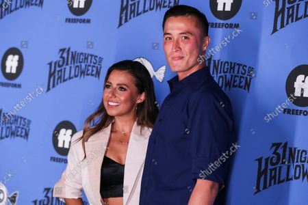 Television personality Katie Thurston and John Hersey arrive at the Freeform 'Halloween Road' Talent And Press Preview Night held at the Heritage Square Museum on September 30, 2021 in Los Angeles, California, United States.
