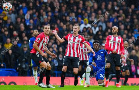 Stock Photo of Callum Hudson-Odoi of Chelsea finds a gap between Oriol Romeu, James Ward-Prowse and Nathan Redmond of Southampton