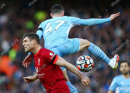 James Milner of Liverpool and Phil Foden of Manchester City
