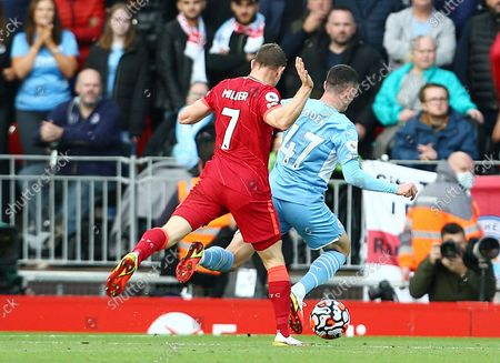 Stock Picture of James Milner of Liverpool brings down Phil Foden of Manchester City