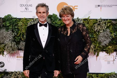 Actor and director of German Film Academy Ulrich Matthes (L) and German State Culture Minister Monika Gruetters pose on the red carpet for the 71st German Film Awards 'LOLA' in Berlin, Germany, 01 October 2021. The most highly endowed cultural award in Germany is presented in several categories by the Deutsche Filmakademie (German film academy).
