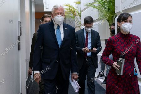 Rep. Steny Hoyer, D-Md., left, arrives for a meeting with House Democrats, on Capitol Hill in Washington