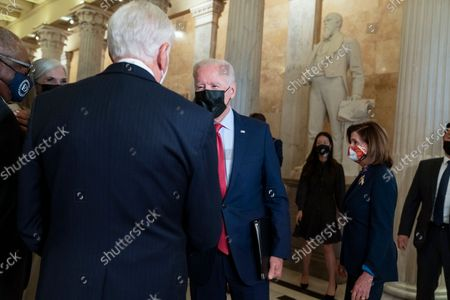 President Joe Biden, left, greets House Majority Leader Steny Hoyer of Md., as he arrives with House Speaker Nancy Pelosi of Calif., right, for a meeting with House Democrats, on Capitol Hill in Washington