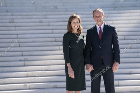 Supreme Court Justice Amy Coney Barrett and husband Jesse Barrett participate in a photo-op outside of the Supreme Court of the United States following a investiture ceremony with Chief Justice of the Supreme Court John Roberts in Washington, DC on Friday October 1, 2021.