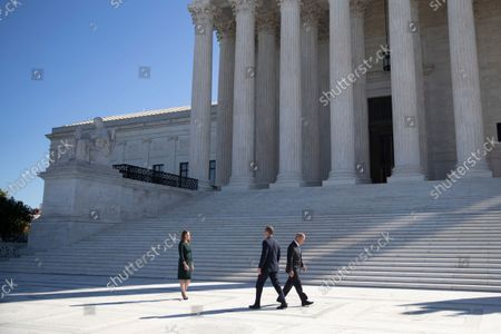 Associate Justice Amy Coney Barrett, her husband Jesse Barrett (C) and Chief Justice John Roberts (R) participate in Justice Coney Barrett's investiture ceremony at the Supreme Court in Washington, DC, USA, 01 October 2021.