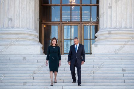 Stock Photo of Associate Justice Amy Coney Barrett and Chief Justice John Roberts participate in Justice Coney Barrett's investiture ceremony at the Supreme Court in Washington, DC, USA, 01 October 2021.