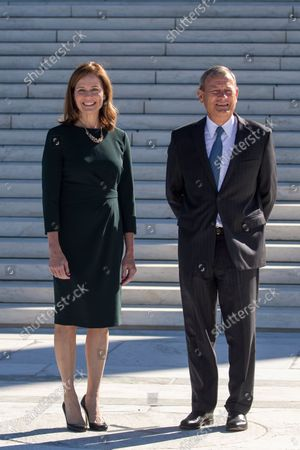 Stock Picture of Associate Justice Amy Coney Barrett and Chief Justice John Roberts participate in Justice Coney Barrett's investiture ceremony at the Supreme Court in Washington, DC, USA, 01 October 2021.