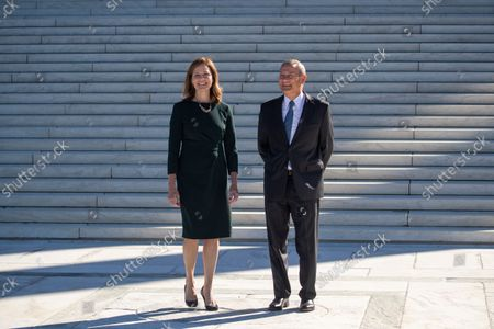 Associate Justice Amy Coney Barrett and Chief Justice John Roberts participate in Justice Coney Barrett's investiture ceremony at the Supreme Court in Washington, DC, USA, 01 October 2021.