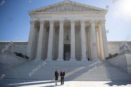 Stock Image of Associate Justice Amy Coney Barrett and Chief Justice John Roberts participate in Justice Coney Barrett's investiture ceremony at the Supreme Court in Washington, DC, USA, 01 October 2021.