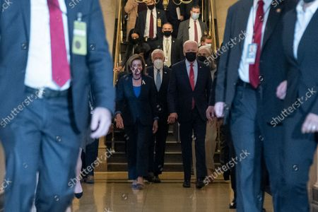 President Joe Biden, right, with House Speaker Nancy Pelosi of Calif., and House Majority Leader Steny Hoyer of Md., center, arrive for a House Democratic Caucus meeting on Capitol Hill, in Washington