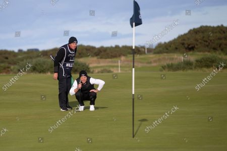 Danny Willett of England lines up a putt on the 15th green during the final round of the Alfred Dunhill Links Championship on the Old Course, St Andrews; The Old Course, St Andrews Links, Fife, Scotland; European Tour, Alfred Dunhill Links Championship, Fourth round.