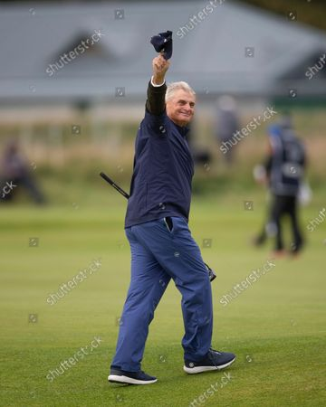 American investment banker and philanthropist Jimmy Dunne, amateur partner of Danny Willett, raises his hat to the crowd after holing a great putt on the 3rd green during the final round of the Alfred Dunhill Links Championship on the Old Course, St Andrews; The Old Course, St Andrews Links, Fife, Scotland; European Tour, Alfred Dunhill Links Championship, Fourth round.