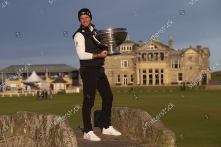 Danny Willett of England poses on the Swilken Bridge with the Alfred Dunhill Links Championship trophy after his win on the Old Course, St Andrews; The Old Course, St Andrews Links, Fife, Scotland; European Tour, Alfred Dunhill Links Championship, Fourth round.