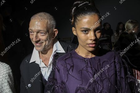 Vincent Cassel, left, and Tina Kunakey attend the Valentino Spring-Summer 2022 ready-to-wear fashion show presented in Paris