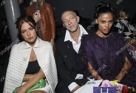 Adele Exarchopoulos, from left, Vincent Cassel and Tina Kunakey attend the Valentino Spring-Summer 2022 ready-to-wear fashion show presented in Paris