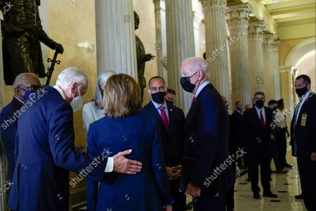 President Joe Biden talks with Rep. James Clyburn, D-S.C., left, Rep. Steny Hoyer, D-Md., second from right, House Speaker Nancy Pelosi of Calif., center, and Rep. Hakeem Jeffries, D-N.Y., as he arrives on Capitol Hill in Washington, for a meeting with the House Democratic caucus to try to resolve an impasse around the bipartisan infrastructure bill