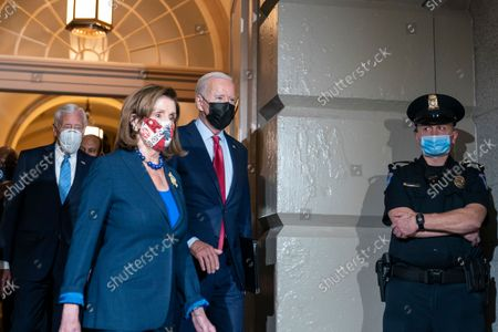 President Joe Biden, right, and House Speaker Nancy Pelosi of Calif., followed by House Majority Leader Steny Hoyer of Md., left, arrive for a House Democratic Caucus meeting on Capitol Hill, in Washington