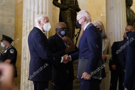 United States President Joe Biden is greeted by United States House Majority Leader Steny Hoyer (Democrat of Maryland) as he arrives on Capitol Hill to speak with members of the House Democratic Caucus, in Washington, DC, USA, 01 October 2021.  Looking on is United States House Majority Whip James Clyburn (Democrat of South Carolina). US President Joe Biden visits Capitol Hill to meet with the House Democratic Caucus and push for passage of his infrastructure plan.