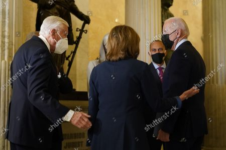 Stock Image of United States President Joe Biden, escorted by Speaker of the US House of Representatives Nancy Pelosi (Democrat of California), greeted by United States House Majority Leader Steny Hoyer (Democrat of Maryland) as he arrives on Capitol Hill to speak with members of the House Democratic Caucus, in Washington, DC, USA, 01 October 2021.  Looking on is US Representative Hakeem Jeffries (Democrat of New York). US President Joe Biden visits Capitol Hill to meet with the House Democratic Caucus and push for passage of his infrastructure plan.
