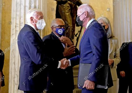 United States President Joe Biden is greeted by United States House Majority Leader Steny Hoyer as he arrives to talk with the House Democratic Caucus about the $1 trillion infrastructure plan at the U.S. Capitol in Washington, DC on Friday, October 1, 2021.