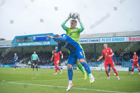 Gillingham Defender Max Ehmer (5) and Wigan Athletic's goalkeeper Ben Amos (12) challenge for the ball during the EFL Sky Bet League 1 match between Gillingham and Wigan Athletic at the MEMS Priestfield Stadium, Gillingham