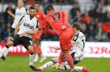 Joel Piroe of Swansea tries a shot on goal but is stopped by Richard Stearman of Derby